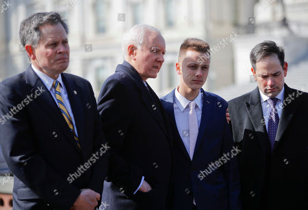 Stock Image of Orin Hatch, Patrick Petty, Marco Rubio, Steve Daines. Sen. Orrin Hatch, R-Utah, center, puts his arm around Patrick Petty, 17, from Parkland, Fla., during a news conference with Sen. Steve Daines, R-Mont., left, and Sen. Marco Rubio, R-Fla., right, on Capitol Hill in Washington, . Petty's sister Alaina Petty, one of the victims of the Parkland school shooting. Hatch is the lead sponsor of the school safety bill, aiming to replicate the success of a program in his home state of Utah