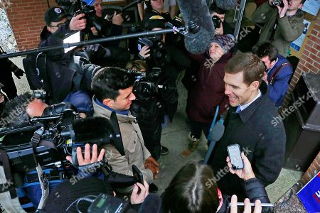 Conor Lamb, the Democratic candidate in a special election in Pennsylvania's 18th Congressional District, right, talks with reporters after taking his grandmother Barbara Lamb to vote in Carnegie, Pa., . Voters in western Pennsylvania are set to choose between Republican Rick Saccone and Democrat Conor Lamb in a special congressional election that could offer signs of what's to come in November's midterms