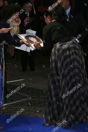 Oprah Winfrey signs autographs