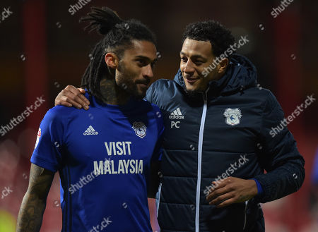 Armand Traore of Cardiff City and Nathaniel Mendez-Laing celebrate at full-time