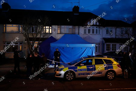 Police are seen at the house of Russian exile Nikolai Glushkov in south west London. Mr Glushkov,  a friend the late oligarch Boris Berezovsky, and a former deputy director of Russian state airline Aeroflot, died at his home in Monday night.