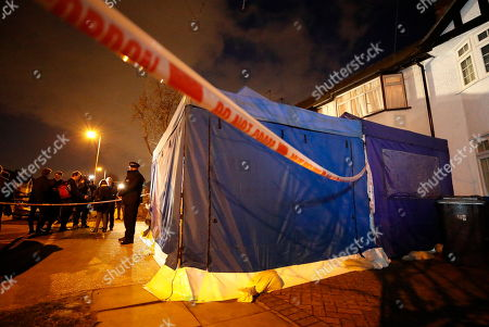 A police evidence tent covers the drive of the  house of Russian exile Nikolai Glushkov in south west London. Mr Glushkov, a friend the late oligarch Boris Berezovsky, and a former deputy director of Russian state airline Aeroflot, died at his home in Monday night. Photo