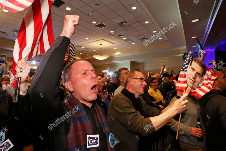 Stock Photo of John Henninger, Eric Larson. John Henninger, left, and Eric Larson, right, of Cecil Township, Pa., watches early returns at the election night party of Conor Lamb, the Democratic candidate for the special election in Pennsylvania's 18th Congressional District, in Canonsburg, Pa., . The Pennsylvania congressional race between Democrat Conor Lamb and Republican Rick Saccone remains too close to call, with local elections officials still counting absentee ballots late Tuesday