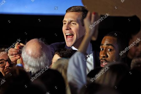 Stock Picture of Conor Lamb, the Democratic candidate for the March 13 special election in Pennsylvania's 18th Congressional District, center, celebrates with his supporters at his election night party in Canonsburg, Pa., early . A razor's edge separated Lamb and Republican Rick Saccone early Wednesday in their closely watched special election in Pennsylvania, where a surprisingly strong bid by first-time candidate Lamb severely tested Donald Trump's sway in a GOP stronghold