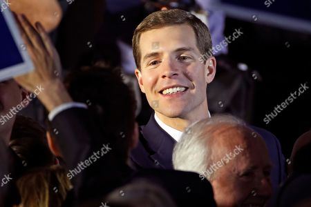 Conor Lamb, the Democratic candidate for the March 13 special election in Pennsylvania's 18th Congressional District, center, celebrates with his supporters at his election night party in Canonsburg, Pa., early . A razor's edge separated Lamb and Republican Rick Saccone early Wednesday in their closely watched special election in Pennsylvania, where a surprisingly strong bid by first-time candidate Lamb severely tested Donald Trump's sway in a GOP stronghold