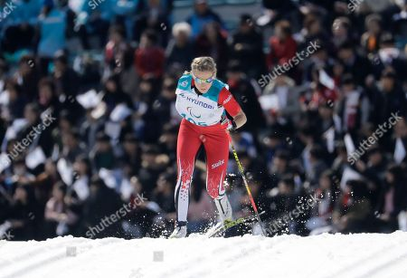 Emily Young of Canada competes in the qualification of the women's 1.5km sprint classic, standing, cross-country skiing at the 2018 Winter Paralympics in Pyeongchang, South Korea