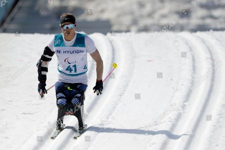 Gold medal winner Oksana Masters of the United States competes in the qualification of the women's 1.1km sprint, sitting, cross-country skiing at the 2018 Winter Paralympics in Pyeongchang, South Korea