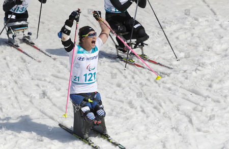 Gold medal winner Oksana Masters of the United States celebrates after winning the women's 1.1km sprint, sitting, cross-country skiing at the 2018 Winter Paralympics in Pyeongchang, South Korea