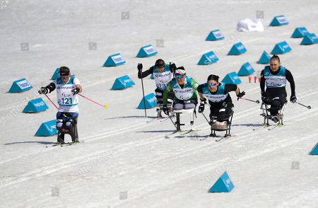 Stock Picture of Gold medal winner Oksana Masters of the United States, left, competes in the final of the women's 1.1km sprint, sitting, cross-country skiing at the 2018 Winter Paralympics in Pyeongchang, South Korea