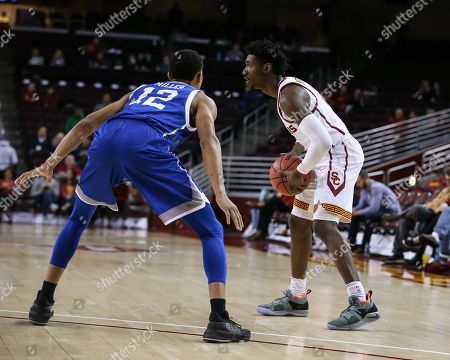 Los Angeles, CA..North Carolina-Asheville Bulldogs guard Raekwon Miller (12) playing defense on USC Trojans guard Jonah Mathews (2)during the UNC Asheville vs USC Trojans at Galen Center on , 2018. (Photo by Jevone Moore / Cal Sport Media)