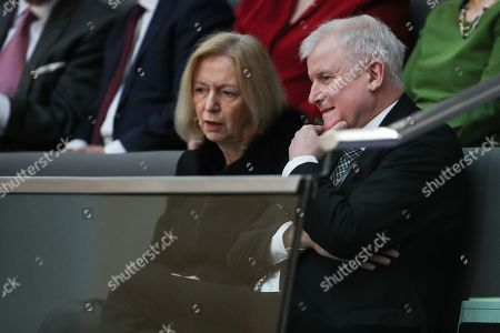 Stock Photo of German Education Minister, Johanna Wanka (L) and Horst Seehofer (R), designated Minister of Interior, Construction and Homeland, during the election of the Federal Chancellor at the Bundestag in Berlin, Germany, 14 March 2018. A coalition of Christian Democratic Union (CDU), Christian Social Union (CSU) and Social Democratic Party (SPD) forms the new German government.