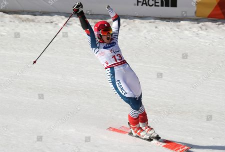Alpine Skiing Women's Giant Slalom Standing gold medalist Marie Bochet of France celebrates after finishing her run for the 2018 Winter Paralympics at the Jeongseon Alpine Center in Jeongseon, South Korea
