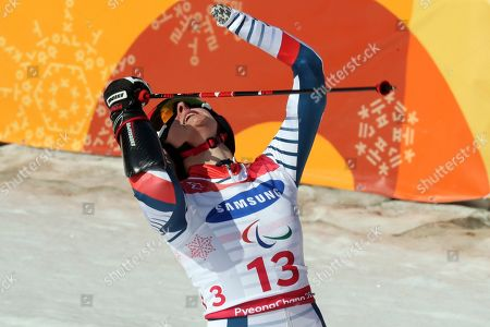 Stock Photo of Alpine Skiing Women's Giant Slalom Standing gold medalist Marie Bochet of France celebrates after finishing her run for the 2018 Winter Paralympics at the Jeongseon Alpine Center in Jeongseon, South Korea