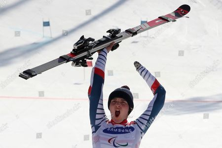 Winners of the Alpine Skiing Women's Giant Slalom Standing gold medalist Marie Bochet of France celebrates during a ceremony for the 2018 Winter Paralympics at the Jeongseon Alpine Center in Jeongseon, South Korea
