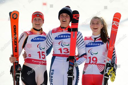 Winners of the Alpine Skiing Women's Giant Slalom Standing from left silver medalist Andrea Rothfuss of Germany, gold medalist Marie Bochet of France and bronze medalist Mollie Jepsen of Canada pose for photos during a ceremony for the 2018 Winter Paralympics at the Jeongseon Alpine Center in Jeongseon, South Korea