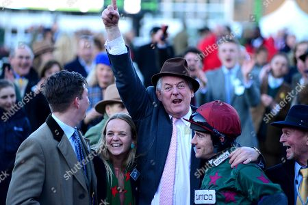 Stock Photo of Cheltenham. MISTER WHITAKER winning owner Tim Radford and Brian Hughes after their win.