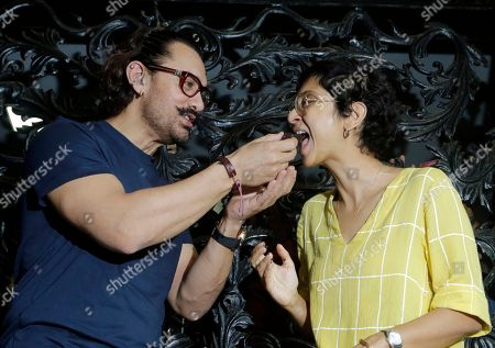 Aamir Khan, Kiran Rao. Bollywood actor Aamir Khan offers a piece of cake to wife Kiran Rao as he celebrates his birthday at his residence in Mumbai, India