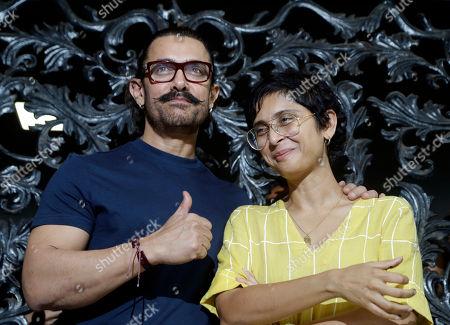 Aamir Khan, Kiran Rao. Bollywood actor Aamir Khan gestures to media with his wife Kiran Rao as he celebrates his birthday at his residence in Mumbai, India