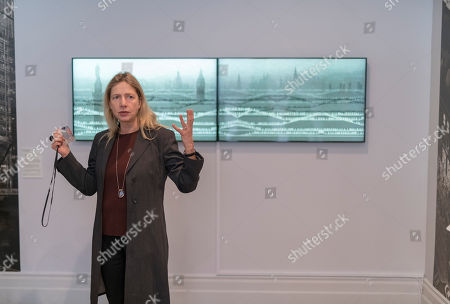 Iwona Blazwick, Director, Whitechapel Gallery in front of Michael Rovner's artwork for Canary Wharf Station.