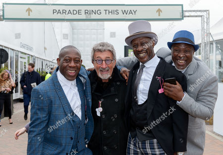 Eddie Jordan poses for a photo with social racegoers