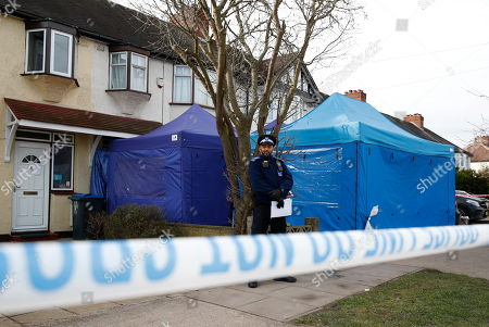 A police evidence tent still covers the drive of the house of Russian exile Nikolai Glushkov in south west London. Mr Glushkov, a friend of oligarch Boris Berezovsky, and a former deputy director of Russian state airline Aeroflot, died at his home in Monday night.
