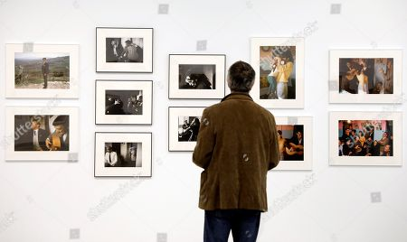 A visitor attends the presentation of the exhibition 'Out of the Darkness' by US Joel Meyerowitz at Bombas Gens Centre d?Art in Valencia, eastern Spain, 14 March 2018.The exhibition includes 98 photographs from the Per Amor a l?Art Collection, most of which were taken in Malaga between 1966 and 1967.