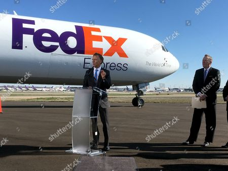 Tennessee Gov. Bill Haslam, left, talks to reporters about a newly announced $1 billion investment by FedEx Corp. at its hub in Memphis, Tenn., on . FedEx Express President and CEO David Cunningham, right, joined Haslam on the tarmac of Signature Flight Support at Memphis International Airport