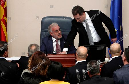 Nikola Gruevski, Talat Xhaferi. The lawmaker of the opposition VMRO DPMNE party Nikola Gruevski, right, tries to stop the parliament speaker Talk Xhaferi, center, during the voting for the law to make Albanian the second official language in the country, on a parliament session in Skopje, Macedonia, . Macedonian parliament has approved for the second time the law making Albanian the second official language in the country after the country's president Gjorge Ivanov in January has vetoed the bill, describing it as unconstitutional and unnecessary