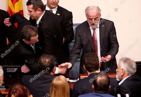 Nikola Gruevski, Talat Xhaferi. The lawmaker of the opposition VMRO DPMNE party Nikola Gruevski, left, tries to stop the parliament speaker Talk Xhaferi, right, during the voting for the law to make Albanian the second official language in the country, on a parliament session in Skopje, Macedonia, . Macedonian parliament has approved for the second time the law making Albanian the second official language in the country after the country's president Gjorge Ivanov in January has vetoed the bill, describing it as unconstitutional and unnecessary