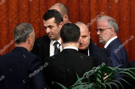 Nikola Gruevski, Talat Xhaferi. The parliament security intervene as the lawmaker of the opposition VMRO DPMNE party Nikola Gruevski, center front, confronts the parliament speaker Talk Xhaferi, right, during the voting for the law to make Albanian the second official language in the country, on a parliament session in Skopje, Macedonia, . Macedonian parliament has approved for the second time the law making Albanian the second official language in the country after the country's president Gjorge Ivanov in January has vetoed the bill, describing it as unconstitutional and unnecessary