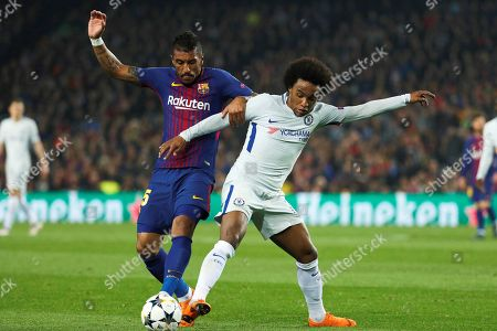 FC Barcelona's Brazilian midfielder Jose Paulo Bezerra 'Paulinho' (L) disputes the ball with William sa Silva (R) of Chelsea at the end of the UEFA Champions League round of 16 second leg soccer match between FC Barcelona and Chelsea FC played at the Camp Nou stadium in Barcelona, Spain, 14 March 2018.