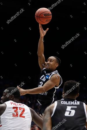 Jashaun Agosto, Randy Phillips. LIU Brooklyn's Jashaun Agosto (3) shoots over Radford's Randy Phillips (32) during the first half of a First Four game of the NCAA men's college basketball tournament, in Dayton, Ohio