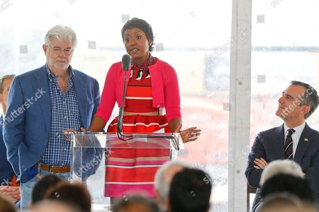 """George Lucas, Mellody Hobson, Eric Garrett. Star Wars"""" creator filmmaker George Lucas and his wife Mellody Hobson, left, attend the groundbreaking ceremony of the on his $1.5 billion Lucas Museum of Narrative Art in Los Angeles . At right, Los Angeles Mayor Eric Garrett looks on. The institution, scheduled to open in 2021, is envisioned as not just a repository for """"Star Wars"""" memorabilia but a wide-ranging museum representing all forms of visual storytelling from paintings and drawings to comic strips and digital and traditional films"""