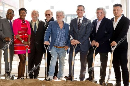"""Stock Picture of Mark Ridley-Thomas, Mellody Hobson, Francis Ford Coppola, Steven Spielberg, George Lucas, Eric Garcetti, Angelo Garcia, Ma Yansong. Left to right: Los Angeles County Supervisor Mark Ridley-Thomas, Mellody Hobson, filmmakers Francis Ford Coppola, Steven Spielberg, and George Lucas, Los Angeles Mayor Eric Garcetti, Angelo Garcia, and architect Ma Yansong attend the groundbreaking ceremony of the Lucas Museum of Narrative Art in Los Angeles . The institution, scheduled to open in 2021, is envisioned as not just a repository for """"Star Wars"""" memorabilia but a wide-ranging museum representing all forms of visual storytelling from paintings and drawings to comic strips and digital and traditional films"""