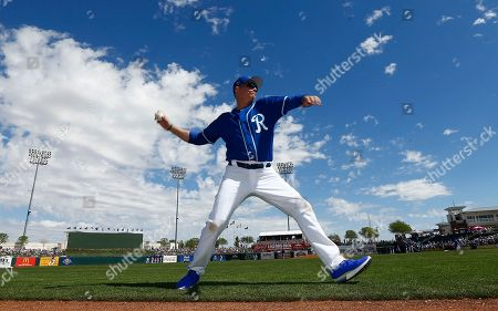 Actor Jim Caviezel warms up before throwing out the first pitch at a spring training baseball game between the Kansas City Royals and the Chicago Cubs, in Surprise, Ariz. The Royals defeated the Cubs 7-6