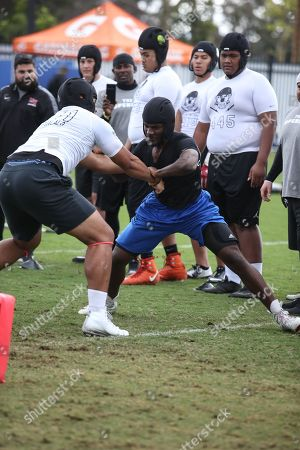OL Mater Dei Luke Felix-Fualalo #441 battling dl Culver City Charles Taylor #152 at the Nike Football The Opening Regional Los Angeles on at Chargers Practice Facility. Photo by Jevone Moore