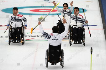 From left South Korean players Jung Seung-won, Set Soon-seok, Bang Min-Ja and Cha Jae-goan celebrate after defeating China in a Wheelchair Curling Round Robin Session for the 2018 Winter Paralympics at the Gangneung Curling Centre in Gangneung, South Korea