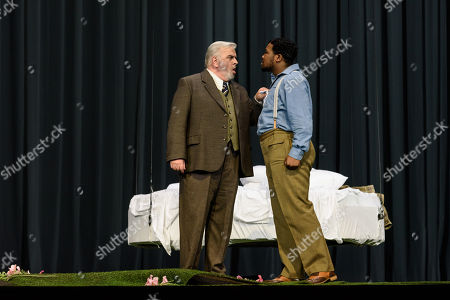 Stock Photo of Alan Opie (Giorgio Germont), Lukhanyo Moyake (Alfredo Germont).