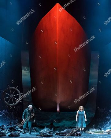 US baritone Todd Thomas as 'Dutchman', left, and Dutch soprano Kelly God as 'Senta' perform during the media rehearsal of Richard Wagner's opera 'The flying Dutchman' under the direction of Guy Montavon and with Chinese conductor Xu Zhong in Erfurt, central Germany, . Premiere of the opera is on Saturday, March 17, 2018