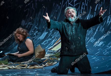 Stock Photo of US baritone Todd Thomas as 'Dutchman' and Dutch soprano Kelly God as 'Senta' perform during the media rehearsal of Richard Wagner's opera 'The flying Dutchman' under the direction of Guy Montavon and with Chinese conductor Xu Zhong in Erfurt, central Germany, . Premiere of the opera is on Saturday, March 17, 2018