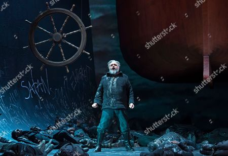 Stock Picture of US baritone Todd Thomas as 'Dutchman' performs during the media rehearsal of Richard Wagner's opera 'The flying Dutchman' under the direction of Guy Montavon and with Chinese conductor Xu Zhong in Erfurt, central Germany, . Premiere of the opera is on Saturday, March 17, 2018