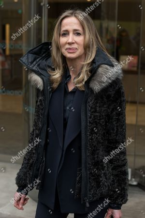 Stock Photo of Michelle Young, the former wife of the late property tycoon Scot Young takes part in photo call at offices of her Bankruptcy Trustee, FRP Advisory, in relation to her divorce settlement.