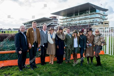 Michael Dickinson, Carl Hester, Carol Vorderman, Richard and Mindy Hammond have a group photo on the racecourse as part of a tour