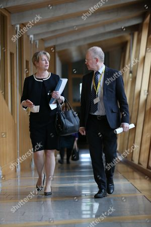 Scottish Parliament First Minister's Questions - Shona Robison, Cabinet Secretary for Health, Wellbeing and Sport, and John Mason make their way to the Debating Chamber.