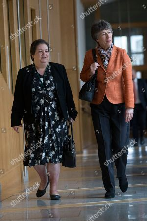 Jackie Baillie and Liz Smith make their way to the Debating Chamber.
