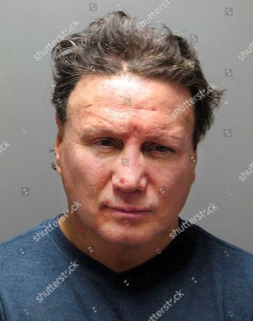 This booking photo released, by the Warwick Police Department shows five-time world boxing champion Vinny Paz, arrested after a domestic incident in Warwick, R.I