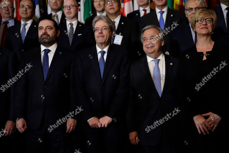 """From left, Lebanese Prime Minister Saad Hariri, Italian Prime Minister Paolo Gentiloni, UN Secretary General Antonio Guterres, and Italian Defense minister Roberta Pinotti, pose during the family photo of the conference """"Lebanon, building trust: a viable security for the country and the region"""" at the Foreign Ministry in Rome"""