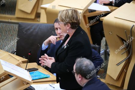 Offensive Behaviour at Football and Threatening Communications (Repeal) (Scotland) Bill - Michael Matheson, Cabinet Secretary for Justice, listens to Annabelle Ewing, Minister for Community Safety and Legal Affairs, defend the bill
