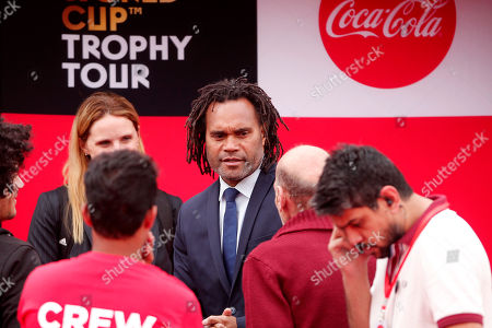 Former French international footballer Christian Karembeu (C) attends an event to showcase the FIFA soccer World Cup trophy in Cairo, Egypt, 15 March 2018. The FIFA trophy tour will cover over 50 countries before returning to Russia in May, ahead the start of the FIFA soccer World Cup 2018.