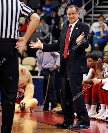 Oklahoma head coach Lon Kruger questions an official during the first half against Rhode Island in the first round of the NCAA men's college basketball tournament in Pittsburgh